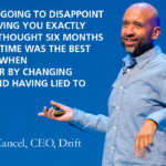 David Cancel speaking on stage. There's a quote overlaying the image, which says